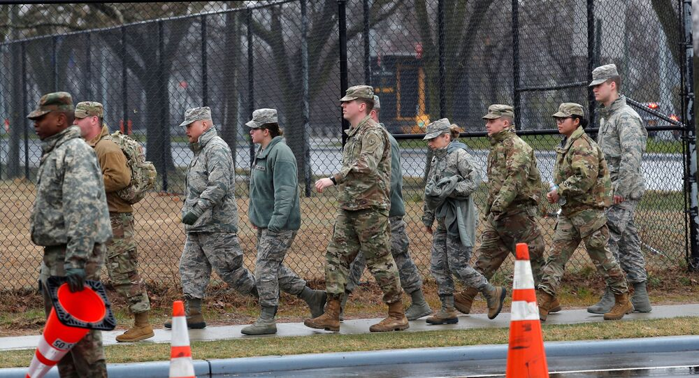 U.S. military personnel walk outside a new coronavirus testing center in the Staten Island borough of New York City, New York, U.S., March 19, 2020