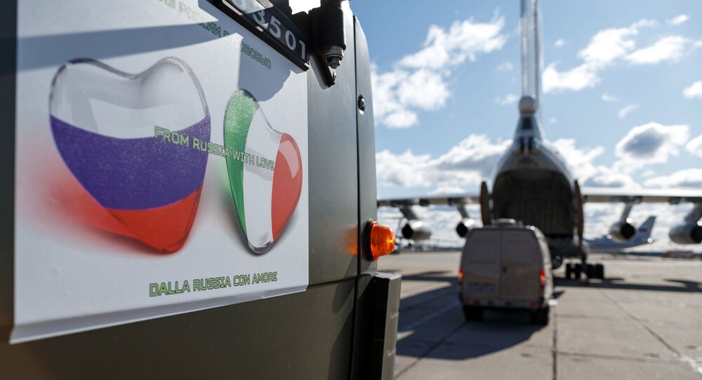 Russian servicemen load medical equipment and special disinfection vehicles into cargo planes while sending the supply to Italy, hit by the outbreak of coronavirus disease (COVID-19), at a military airdrome in Moscow region, Russia March 22, 2020
