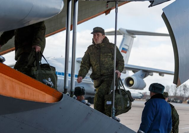 Russian servicemen get on board an Ilyushin Il-76
