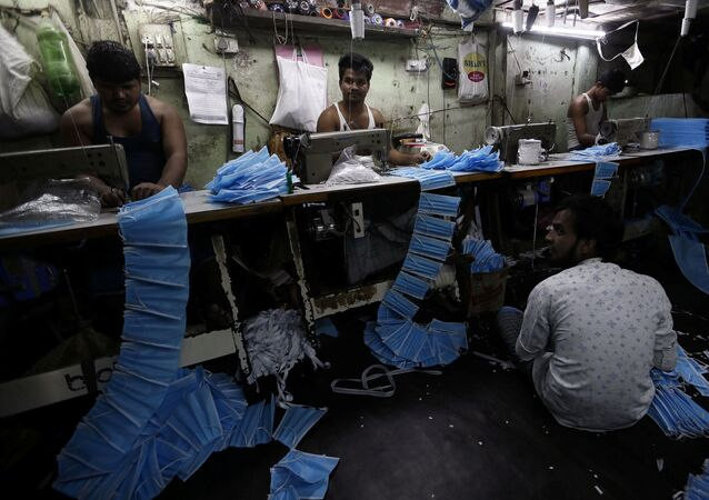 Workers make protective masks inside a workshop in Mumbai, India, March 14, 2020