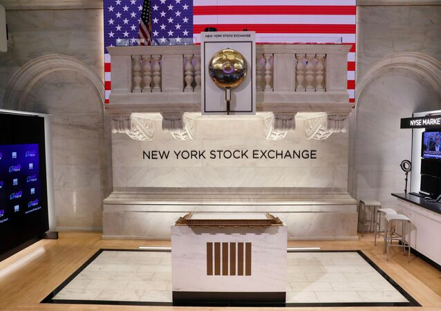 The bell used to open and close the markets hangs in front of an empty podium above the floor of the New York Stock Exchange (NYSE) as it prepares to close due to the coronavirus disease (COVID-19) outbreak in New York, U.S., 20 March, 2020