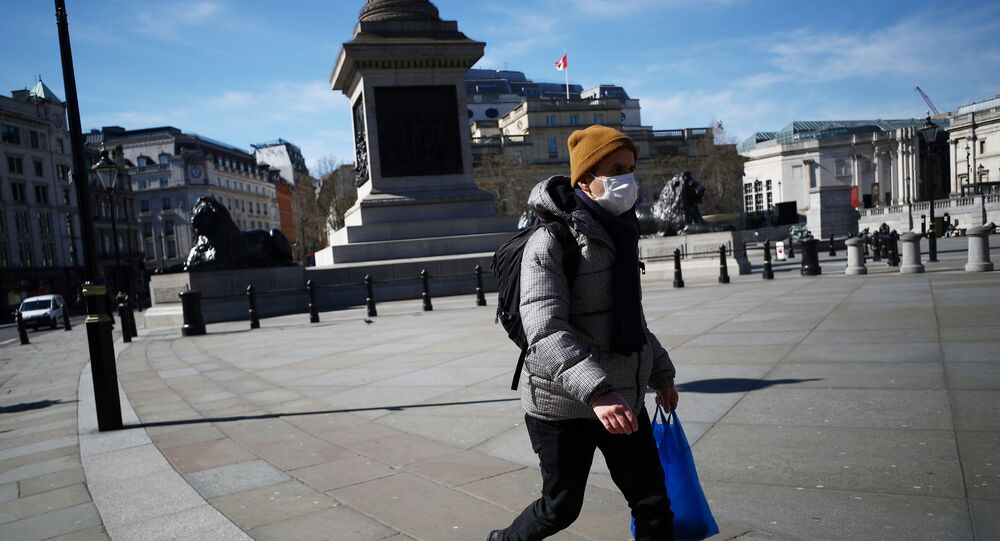A man wears a mask in London's Trafalgar Square as the spread of the coronavirus disease (COVID-19) continues, 23 March 2020