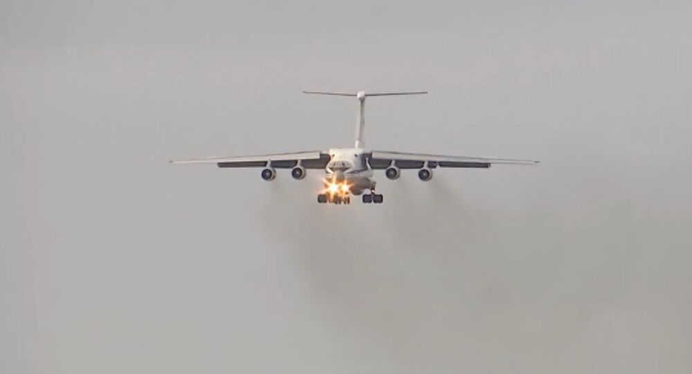 In this handout photo released by the Russian Defence Ministry, an Ilyushin Il-76 with medical equipment for transfer to Coronavirus-Hit Italy lands at the Pratica di Mare military base, Italy. On March 21 Russian President Vladimir Putin offered his support and help in the form of mobile disinfection vehicles and medical specialists to Italian Prime Minister Giuseppe Conte. Editorial use only, no archive, no commercial use.