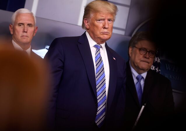 U.S. President Donald Trump looks at a reporter asking a question as he stands with Vice President Mike Pence and Attorney General William Barr during the coronavirus response daily briefing at the White House in Washington, U.S., March 23, 2020.