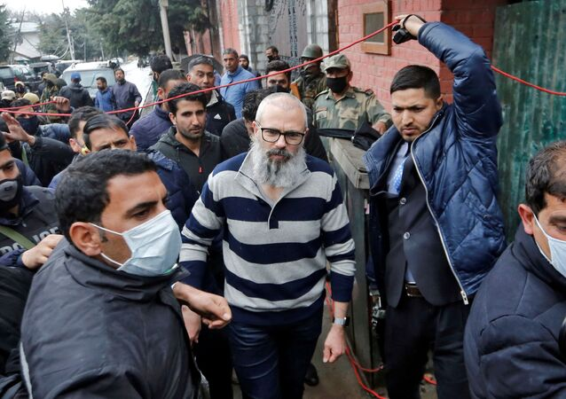 Omar Abdullah, former chief minister of Jammu and Kashmir, walks outside his residence following his release in Srinagar, March 24, 2020