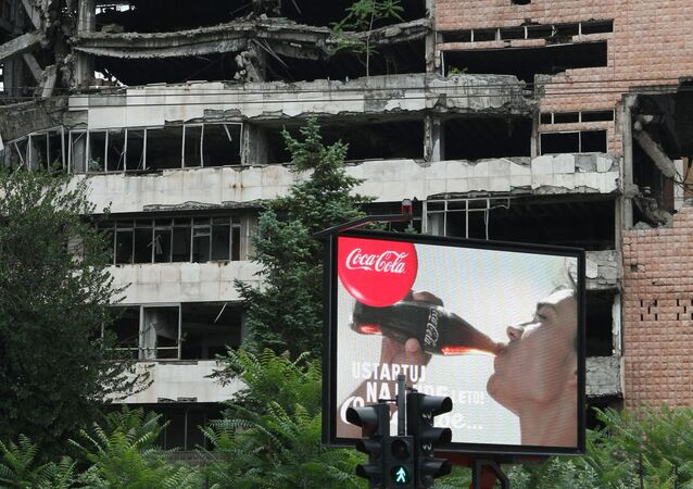 Coca Cola billboard in front of a building in Belgrade damaged during the 1999 NATO airstrikes.