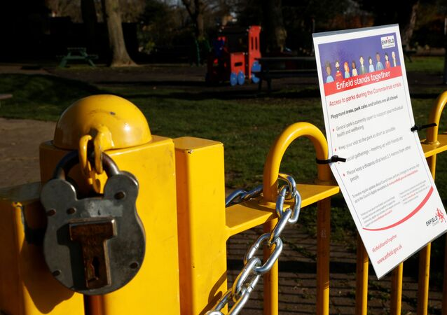 A padlock and a notice is seen at the entrance to a childrens playground in Enfield Town Park, as the spread of the coronavirus disease (COVID-19) continues in Enfield, Britain, March 24, 2020.