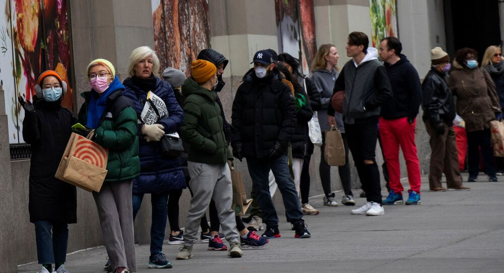 People line up to buy food in a market as the coronavirus disease (COVID-19) outbreak continues in New York, U.S., March 22, 2020.
