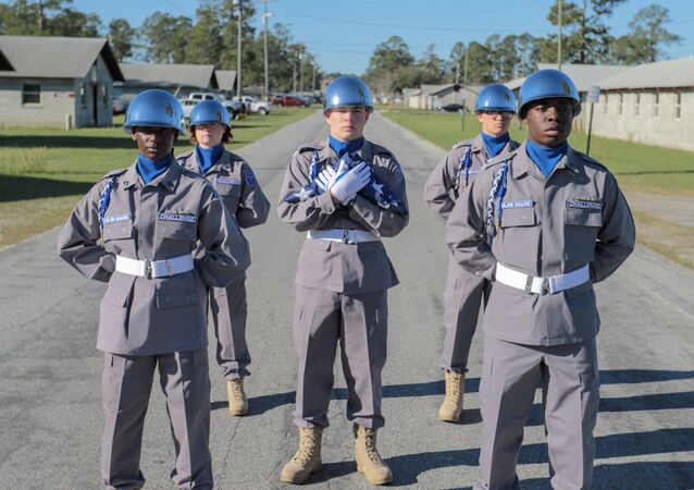 Fort Stewart, Ga., March 3, 2018 - The Georgia National Guard Youth Challenge Academy Color Guard awaits the beginning of the academy's family day activities.  Students are selected to the color guard after a rigorous assessment of their knowledge, physical fitness and leadership abilities.