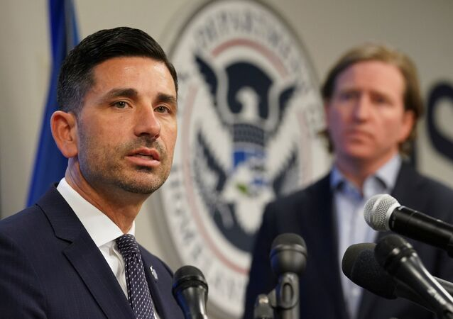 Department of Homeland Security (DHS) Acting Secretary Chad Wolf (L) and Cybersecurity and Infrastructure Security Agency (CISA) Director Christopher Krebs speak to reporters at CISA's Election Day Operation Center on Super Tuesday in Arlington, Virginia, U.S., March 3, 2020