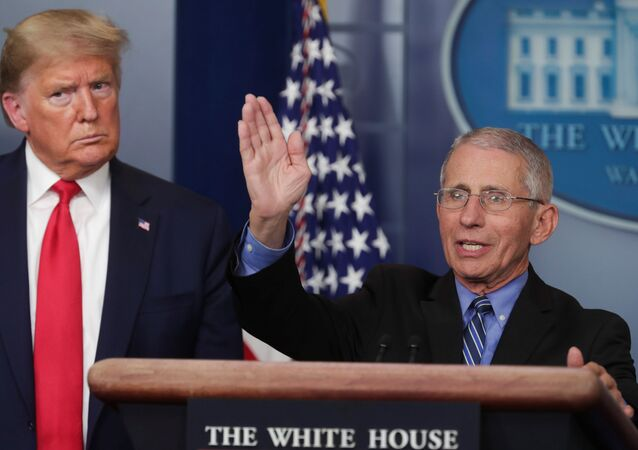 U.S. President Donald Trump listens as Dr. Anthony Fauci, Director of the National Institute of Allergy and Infectious Diseases, addresses the coronavirus task force daily briefing at the White House in Washington, U.S., March 24, 2020.