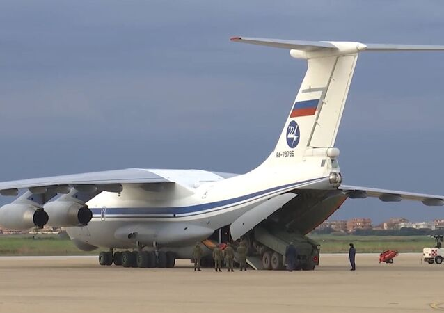 Ilyushin Il-76 carrying medical equipment for transfer to Coronavirus-Hit Italy unloads at the Pratica di Mmare military base, Italy