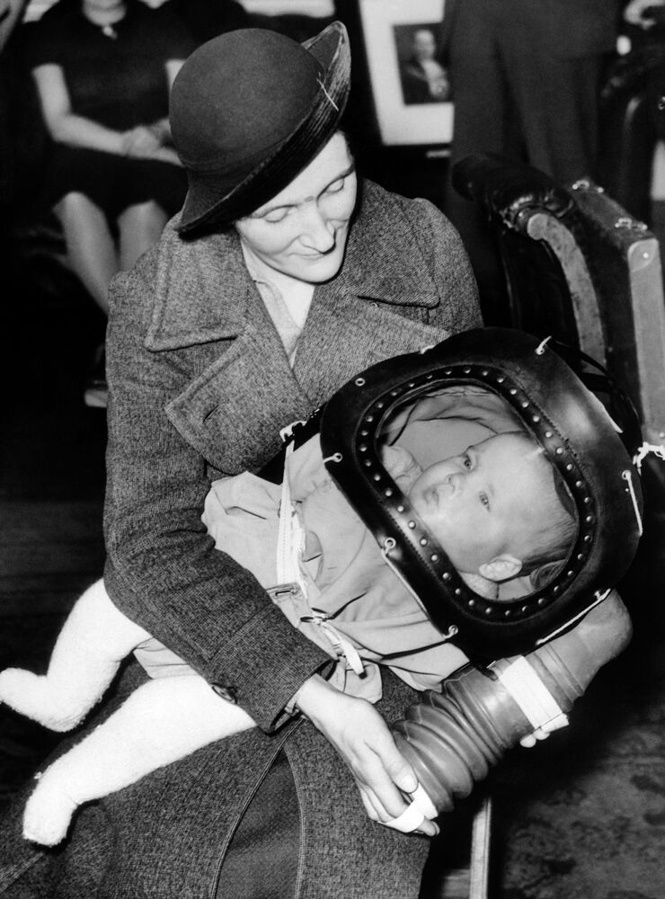 The British government's new gas mask for babies under two, technically known as a baby helmet, was demonstrated for the first time on March 13, 1939, at the Holborn Town Hall in London.