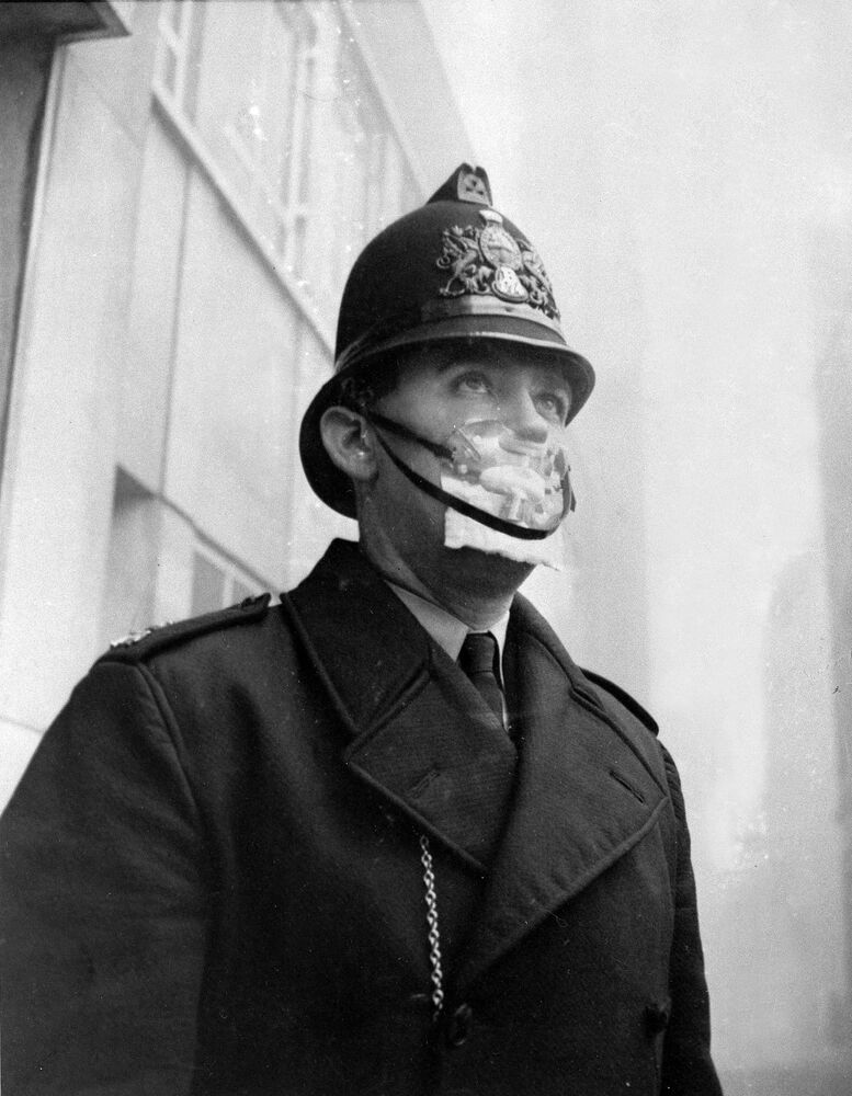 A British bobby, policeman, covers his mouth and nose with a mask to protect himself from the sulphurous smog in England on Dec. 5, 1962.