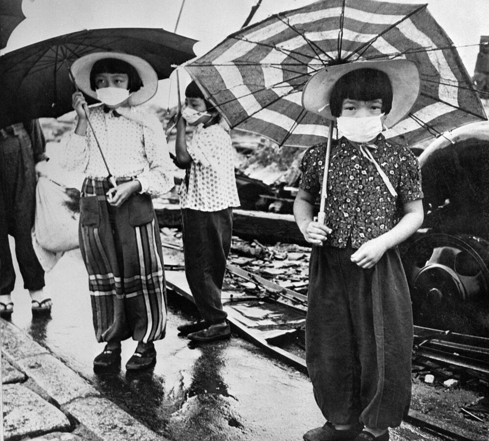 Picture dated 1948 showing children wearing masks to protect themselves from irradiation in the devastated city of Hiroshima after the US nuclear bombing on the city 06 August 1945 during World War II.
