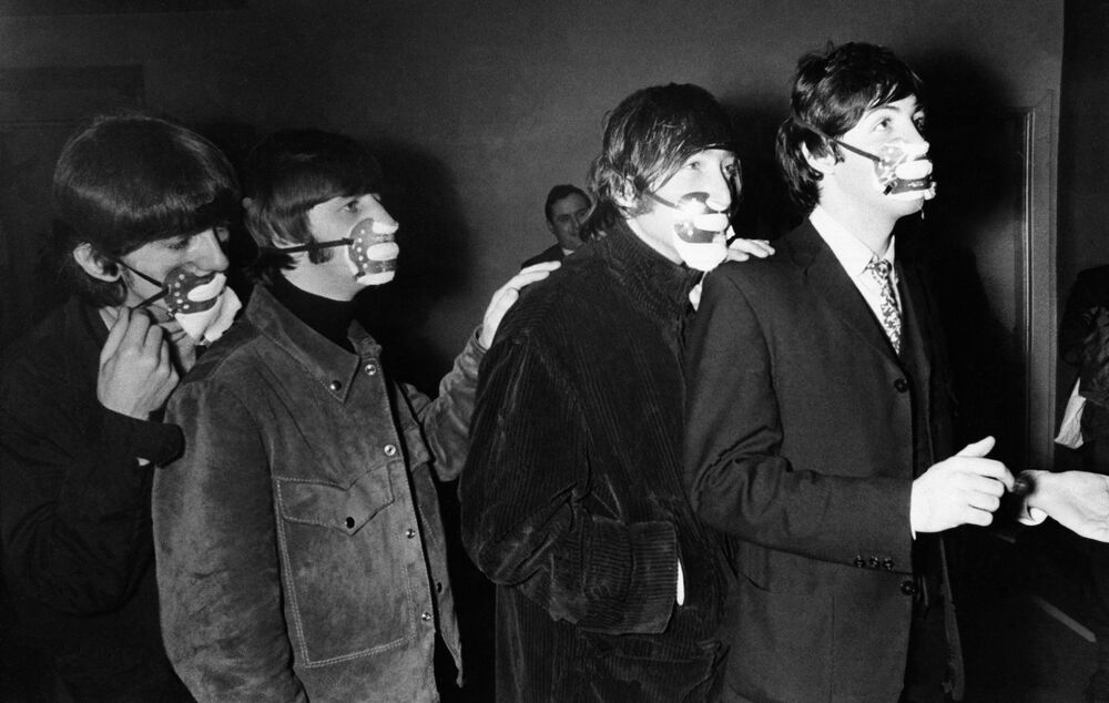 The Beatles are wearing the masks against the effects of fog. The famous beat group from Liverpool--George Harrison, Ringo Starr, John Lennon, and Paul McCartney , from left to right as they arrived for a concert in Ardwick, Manchester,  December 7, 1965  wearing masks.