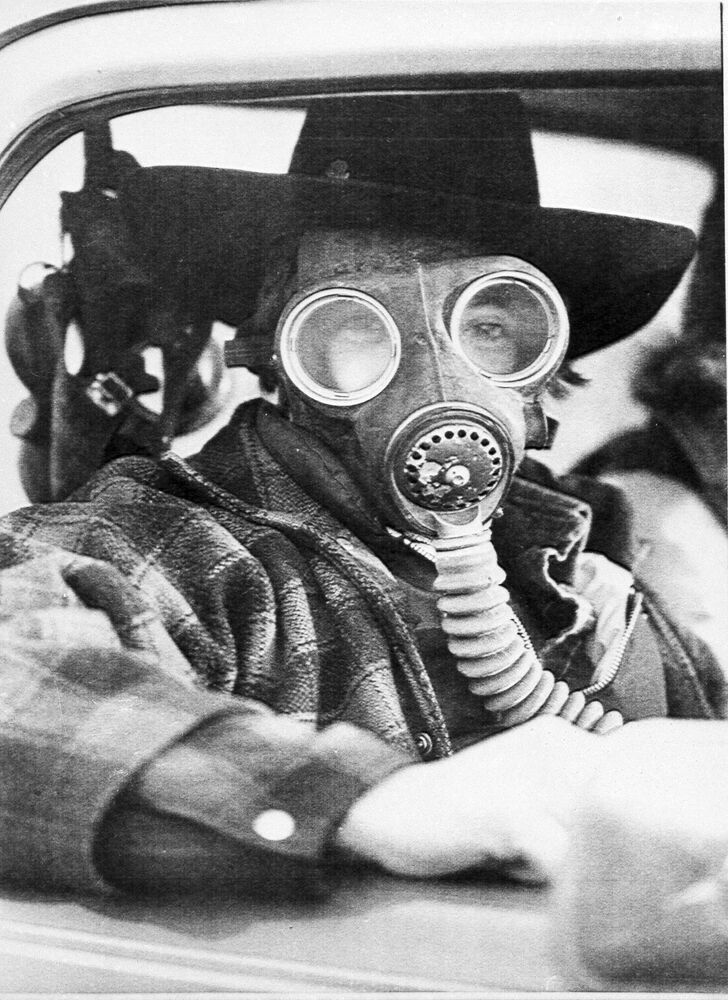 Eric Waltham wears a gas mask while trying to find his way past a roadblock leading into the evacuated city of Mississauga, Ont., Canada, Nov. 12, 1979. The mask was to protect him from any possible eye and breathing problems that were reported in the area. A chemical train derailment caused the evacuation of 220,000 residents.