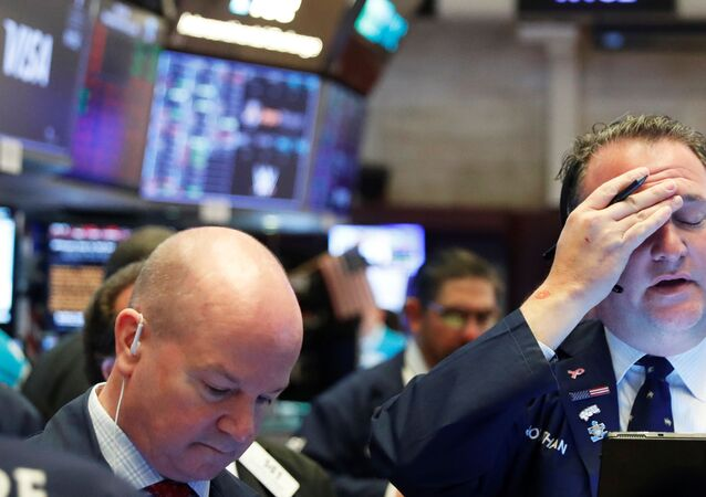 A trader reacts as he works on the floor of the New York Stock Exchange as markets continue to react to the coronavirus disease (COVID-19) at the NYSE in New York, U.S., 18 March 2020.