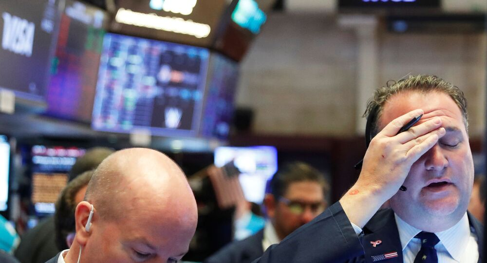 A trader reacts as he works on the floor of the New York Stock Exchange as markets continue to react to the coronavirus disease (COVID-19) at the NYSE in New York, 18 March 2020.