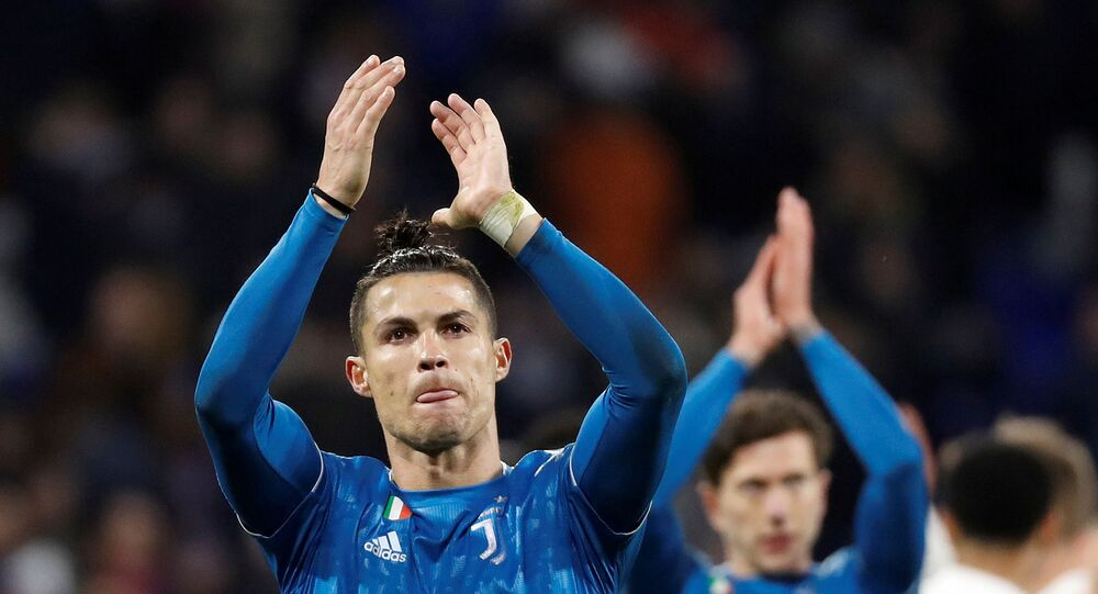 Soccer Football - Champions League - Round of 16 First Leg - Olympique Lyonnais v Juventus - Groupama Stadium, Lyon, France - February 26, 2020  Juventus' Cristiano Ronaldo looks dejected as he applauds fans at the end of the match