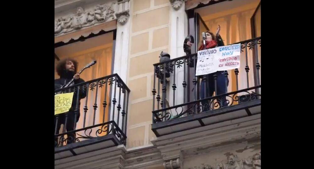 Soul singer gives concert from Madrid balcony during coronavirus lockdown