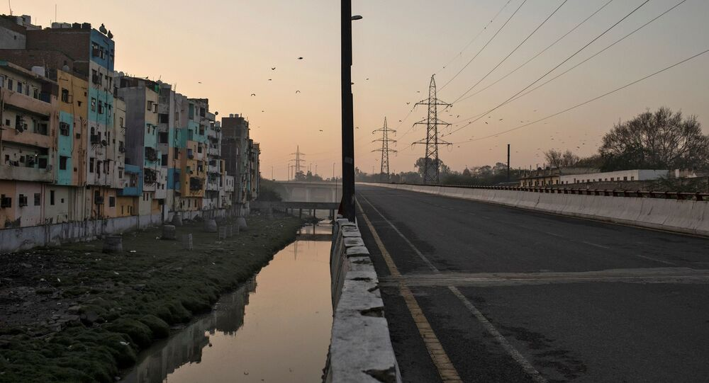 An empty flyover is seen next to residential buildings during 21-day nationwide lockdown to limit the spreading of coronavirus disease (COVID-19), in New Delhi, India, March 25, 2020