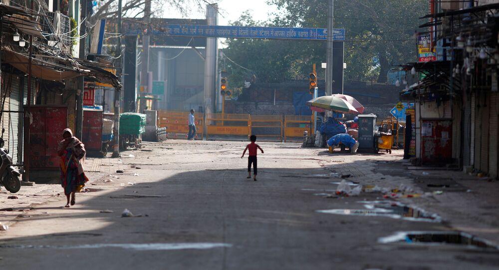 A boy plays on a near-empty street during a lockdown amid a coronavirus disease (COVID-19) outbreak in New Delhi, India, March 25, 2020