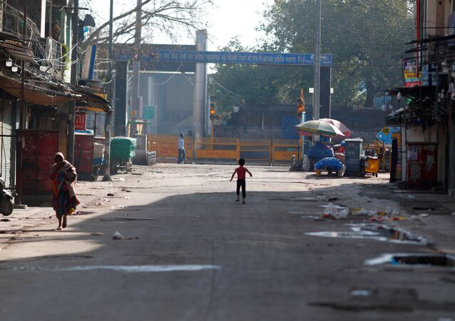 A boy plays on a near-empty street during a lockdown amid a coronavirus disease (COVID-19) outbreak in New Delhi, India, March 25, 2020