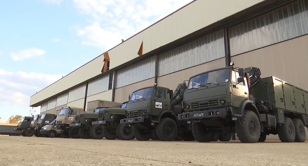 In this handout photo released by the Russian Defence Ministry, trucks with medical equipment for transfer to Coronavirus-Hit Italy are pictured at the Pratica di Mare military base, Italy