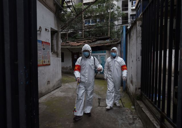 Community workers in protective suits disinfect a residential compound in Wuhan, the epicentre of the novel coronavirus outbreak, Hubei province, China March 6, 2020.