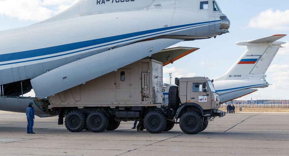 Russian servicemen load medical equipment and special disinfection vehicles into cargo planes while sending the supply to Italy, hit by the outbreak of coronavirus disease (COVID-19), at a military airdrome in Moscow region, Russia March 22, 2020.