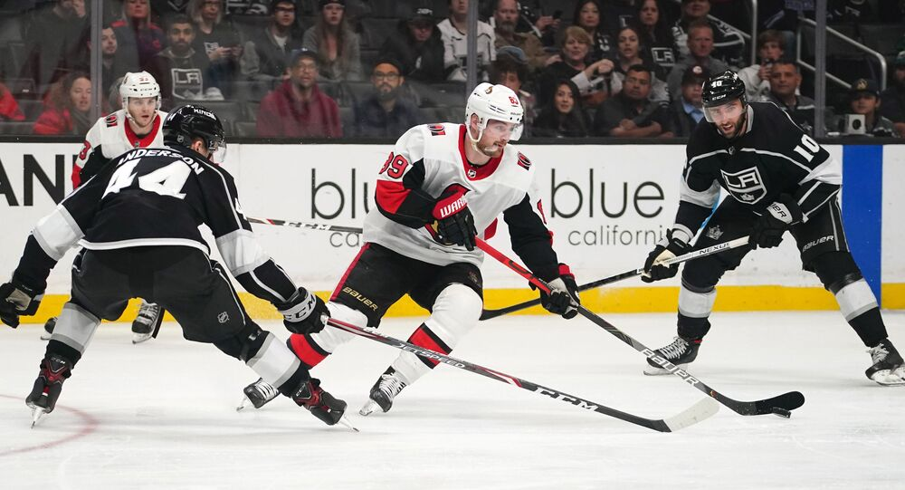 Mar 11, 2020; Los Angeles, California, USA; Ottawa Senators left wing Mikkel Boedker (89) handles the puck under pressure from Los Angeles Kings defenseman Mikey Anderson (44) and center Michael Amadio (10)  in the third period at Staples Center. The Kings won 3-2.