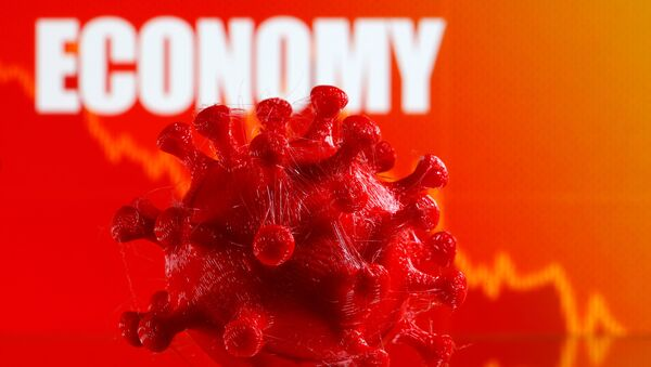 A 3D-printed coronavirus model is seen in front of a stock graph and the word Economy on display in this illustration taken March 25, 2020.  - Sputnik International
