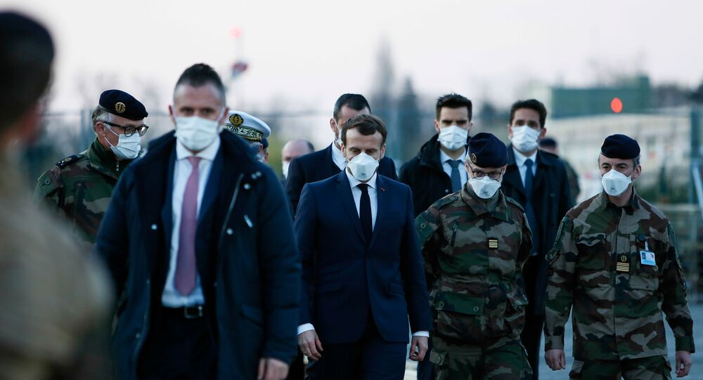 French President Emmanuel Macron wears a face mask during his visit to the military field hospital outside the Emile Muller Hospital in Mulhouse, eastern France March 25, 2020, during a strict lockdown in France to stop the spread of the coronavirus disease (COVID-19).