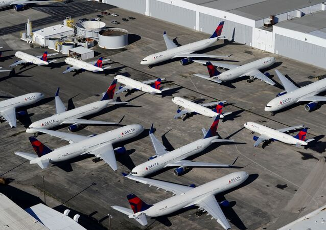 Delta Air Lines passenger planes are seen parked due to flight reductions made to slow the spread of coronavirus disease (COVID-19), at Birmingham-Shuttlesworth International Airport in Birmingham, Alabama, U.S. March 25, 2020.