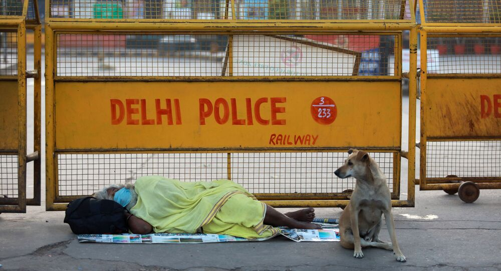 A homeless person sleeps on the pavement outside a railway station during a 21-day nationwide lockdown to limit the spreading of coronavirus disease (COVID-19), in New Delhi, India, March 26, 2020.