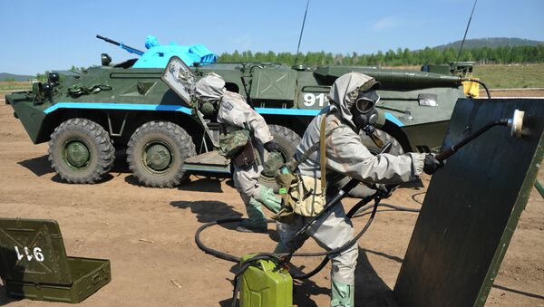 Members of a radiation, chemical and biological reconnaissance team use reagents to disinfect the surface of a dangerous area during the military-district stage of the Safe Environment 2016 army contest, involving radiation, chemical and biological reconnaissance teams in the Trans-Baikal Territory. - Sputnik International