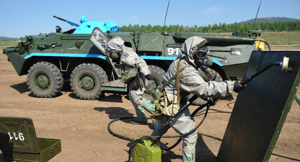 Members of a radiation, chemical and biological reconnaissance team use reagents to disinfect the surface of a dangerous area during the military-district stage of the Safe Environment 2016 army contest, involving radiation, chemical and biological reconnaissance teams in the Trans-Baikal Territory.