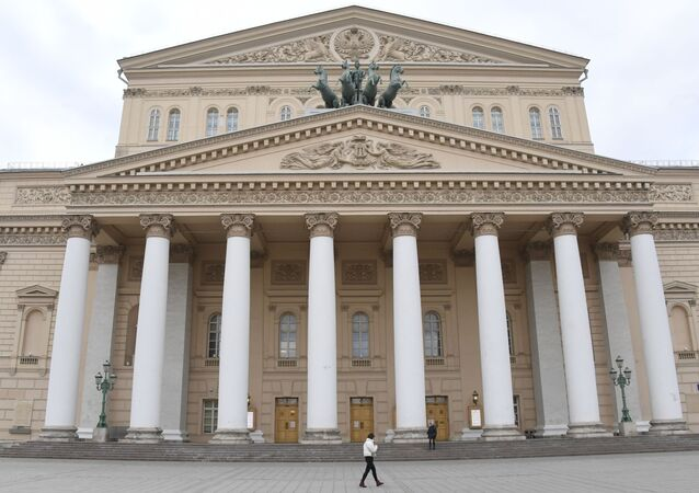 A woman walks past closed amid the coronavirus disease spread Bolshoi Theatre, in Moscow, Russia