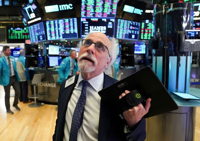 Trader Peter Tuchman works at the New York Stock Exchange (NYSE) in New York, U.S., January 2, 2020.