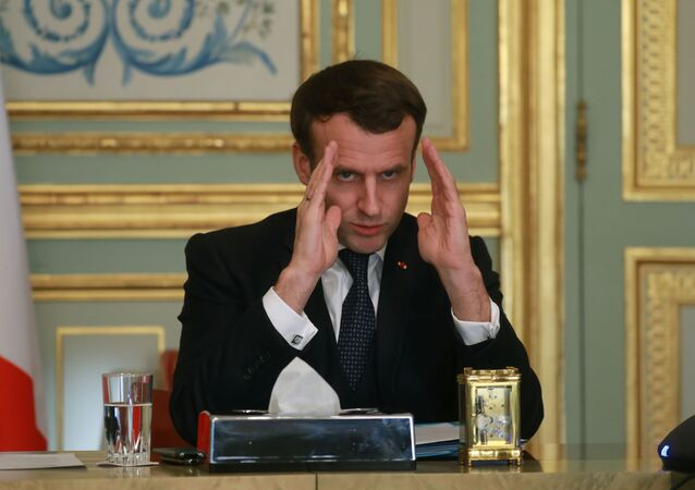 French President Emmanuel Macron gestures during a conference call to install the CARE committee on the novel coronavirus (COVID-19), at the Elysee Palace in Paris, France March 24, 2020.