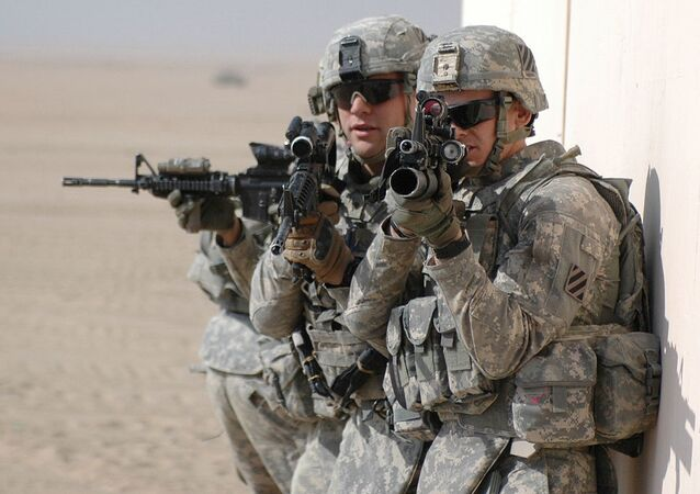 U.S. Army soldiers prepare to clear and secure a building during exercise Hammer Strike at the Udairi Range Complex near Camp Buehring, Kuwait