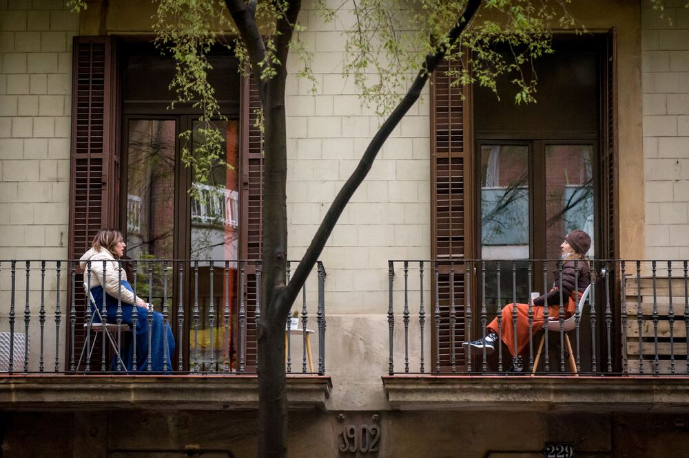 Women communicate with each other from their balconies in Barcelona.