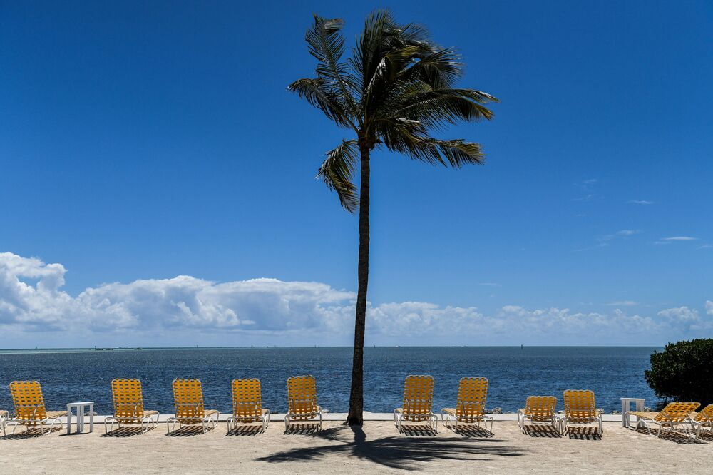 Empty lounge chairs are seen on a deserted beach at a resort in Windley Key, on March 22, 2020, during the coronavirus (COVID-19) outbreak. - The Florida Keys have closed down to visitors. Heavily relying on tourism, at the peak of high season, Florida's most southern holiday islands have been forced to shut down hotels amid the COVID-19 pandemic.