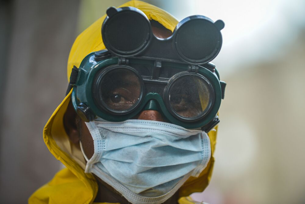 A cleaning staff waers protective gear to disinfect a metro carriage as a prevemtive measure against the spreading of the COVID-19 coronavirus in Addis Ababa, Ethiopia, on March 20, 2020.