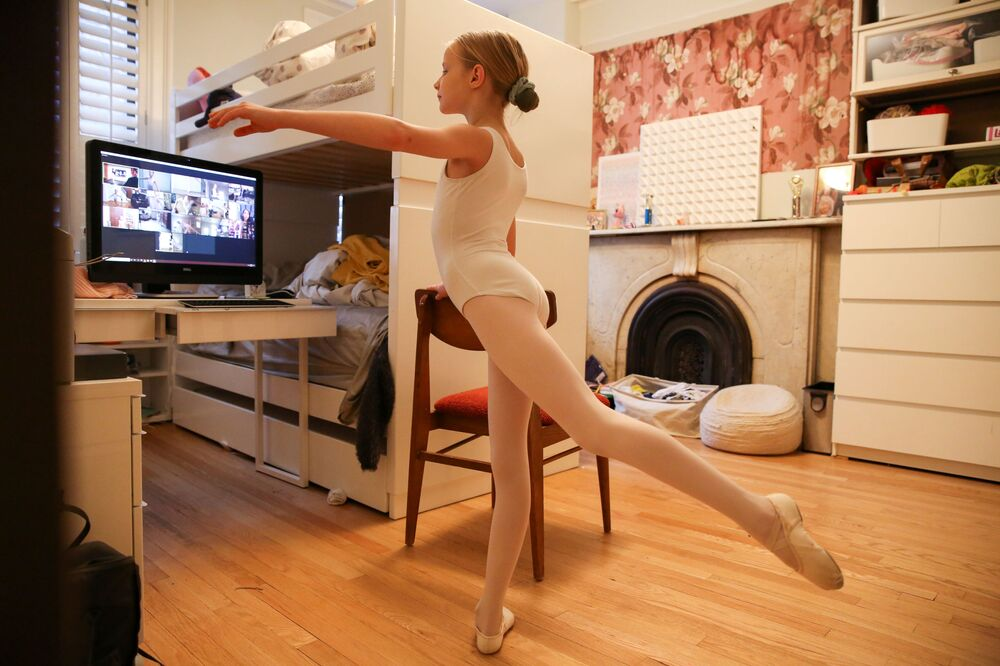 Lydia Hassebroek attends a ballet class from home while practicing social distancing during the outbreak of coronavirus disease (COVID-19) in Brooklyn, New York, U.S., March 25, 2020. Picture taken March 25, 2020.
