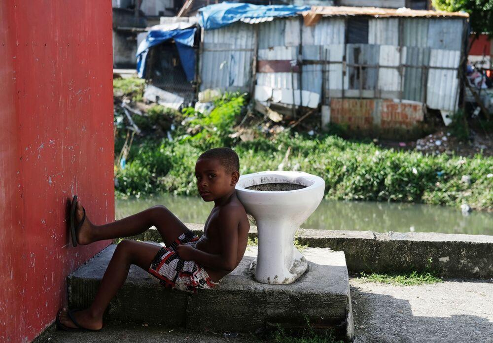 A kid is pictured in Cidade de Deus slum during the coronavirus disease (COVID-19) outbreak in Rio de Janeiro, Brazil, March 22, 2020. Picture taken March 22, 2020.