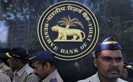 FILE PHOTO: Police stand guard as depositors (unseen) of the Punjab and Maharashtra Co-operative Bank (PMC) attend a protest over the Reserve Bank of India (RBI) curbs on the bank, outside a RBI office in Mumbai, India, October 1, 2019.