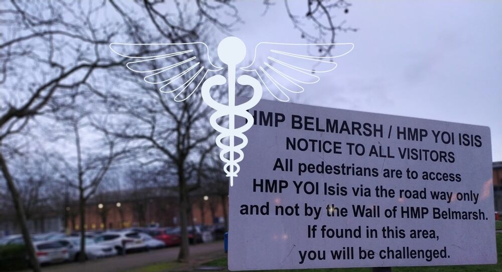 Belmarsh prison with sign to the right and medical emblem