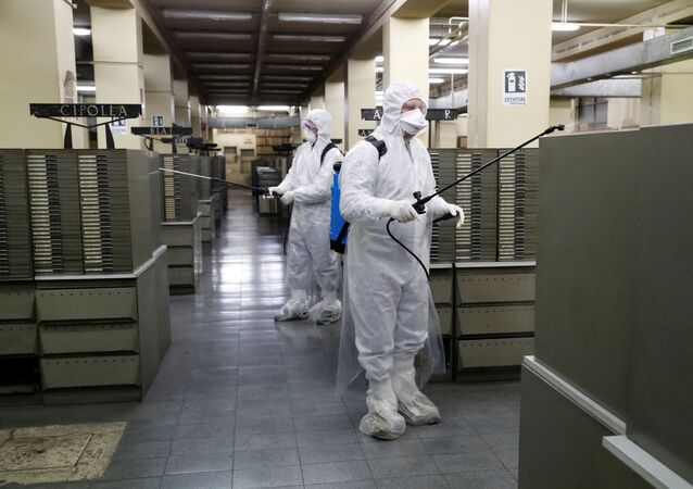 Cleaners sanitise documents inside the archives of Rome's Anagrafe, the city's Registration Office, as the coronavirus disease (COVID-19) spreads, in Rome, Italy, March 27, 2020.